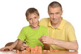 Cute family playing at table — Stock Photo