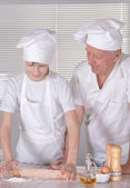 Older man cooking with grandson — Stock Photo