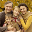 Happy family playing in autumn park — Stock Photo