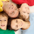 Glad family in bright T-shirts — Stock Photo