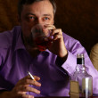 Man with whiskey and cigarette — Stock Photo #34133261