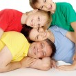 Lovely family in bright T-shirts — Stock Photo