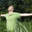 Happy man enjoying fresh air — Stock Photo