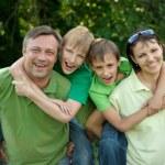 Adorable family having fun — Stock Photo #34134413