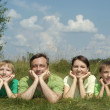 Nice family in a summer park — Stock Photo