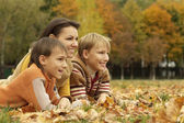 Mother and children are in the park — Stock Photo