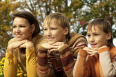Mom and her children on autumn — Stock Photo