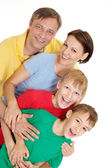 Interesting family in bright T-shirts — Stock Photo