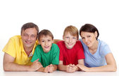 Smart family in bright T-shirts — Stock Photo