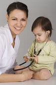 Doctor with a nice child — Stock Photo
