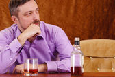 Man and alcohol — Stock Photo