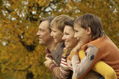 Portrait of happy family relaxing — Stock Photo