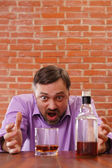 Angry man getting drunk — Stock Photo