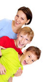 Good-looking family in bright T-shirts — Stock Photo