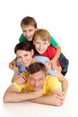Smiling family in bright T-shirts — Stock Photo