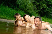 Good family having fun on the river — Stock Photo
