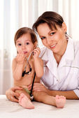 Charming doctor with small patient — Stock Photo