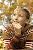Happy boy relaxing in autumn — Stock Photo