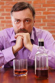Man getting drunk — Stock Photo