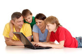 Beautiful family in bright T-shirts — Stock Photo