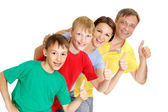Pretty family in bright T-shirts — Stock Photo