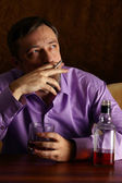 Guy drinking and smoking — Stock Photo