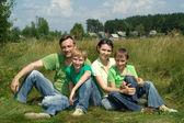 Smiling family having fun — Stock Photo