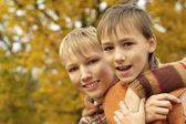 Happy boys relaxing in autumn — Stock Photo