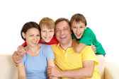 Friendly family in bright T-shirts — Stock Photo
