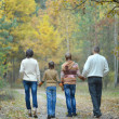 Stock Photo: Happy family on a walk