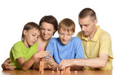 Family in colored T-shirts — Stock Photo