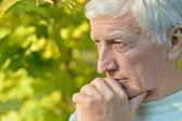 Pensive elderly man — Stock Photo