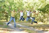 Happy family jumping — Stock Photo