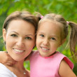 Girl with her mother — Stock Photo