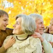 Elderly couple and grandchildren — Stock Photo #35247883