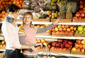 Funny boy with mom in the store — Stock Photo