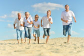 Portrait of a happy family a running barefoot — Stock Photo