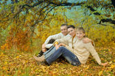 Happy family of three on the nature — Stock Photo