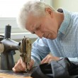 Man at sewing machine — Stock Photo
