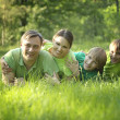 Happy family of four — Stockfoto