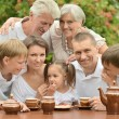 Stock Photo: Family drinking tea outdoors
