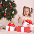 Little girl with Christmas gifts — 图库照片