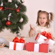 Little girl with Christmas gifts — Stockfoto