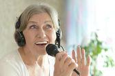 Senior woman singing — Stock Photo