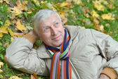 Middle-aged man on grass — Stock Photo