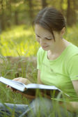 Nice woman reading a book at nature — 图库照片
