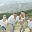 Happy family running — Stock Photo