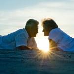 Elderly couple at sunset — Stock Photo #36255889