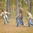 Happy family play football  forest — Stock Photo
