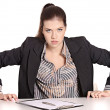 Stock Photo: Angry secretary at table